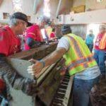 Bucket Brigade moving piano