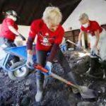 Bucket brigade shoveling mud